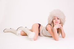 Laying sexy woman in furry hat Stock Photography