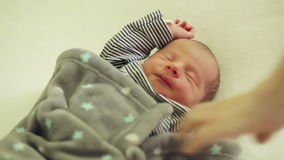 Laying sleeping newborn son stock footage