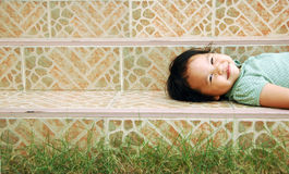 Laying smile kid Royalty Free Stock Photos