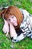 Laying spring redheaded girl Stock Photos