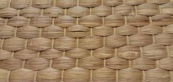 Laying on the table in a cafe with a pattern of straw. royalty free stock photos