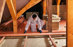 Laying thermal insulation - installing the planking Royalty Free Stock Photography