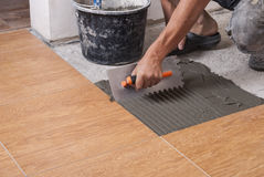 Laying tiles on the floor Royalty Free Stock Image