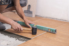 Laying tiles on the floor Stock Photography