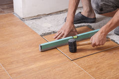 Laying tiles on the floor Royalty Free Stock Photography