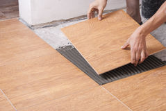 Laying tiles on the floor Stock Images