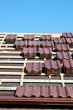 Laying tiles on roof Royalty Free Stock Photo