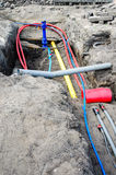 Laying of underground cables and pipes in the residential const Stock Photo