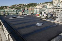 Laying of waterproofing sheathing  and insulation on a roof Stock Photography