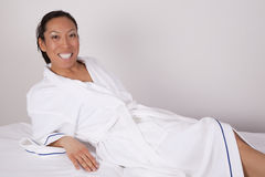 Laying white robe Royalty Free Stock Image