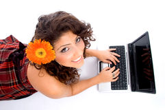 Laying woman with laptop stock photos