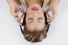 Laying Woman With Headphone Stock Images