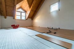 Laying wooden floor during renovations. With tools and a red toolbox behind Royalty Free Stock Image