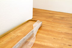 Laying wooden flooring. Laying new wooden laminate flooring Royalty Free Stock Photography
