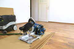 Laying wooden flooring. Laying new wooden laminate flooring Stock Photo