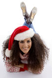 Laying young female with christmas hat Stock Images