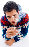 Laying young man posing with cigarette Stock Image