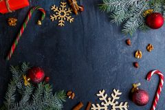 Layout on a background with a place for an inscription, decorated with a Christmas tree branch. Layout on a dark background with a place for an inscription Stock Images