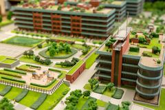 Urban layout. Layout of city streets, blocks of flats, parks and playground to be built in future Royalty Free Stock Photo