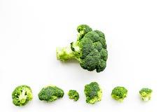 Layout of fresh uncooked broccoli on white background top view copy space. Layout of fresh uncooked broccoli on white background top view Royalty Free Stock Photos