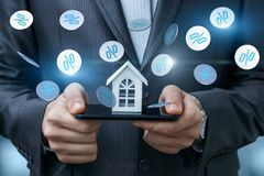 Layout of the house in the phone and fly interest. The concept of discounts on real estate Stock Images
