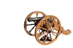 The layout of the old gun on a wooden carriage. Under the po ka stacked iron core. Isolate stock image