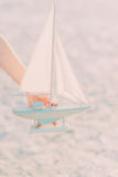 The layout of a sailboat in the hand Stock Photos