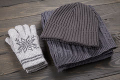 Layout warm clothes. Top view, on a wooden board Stock Photo