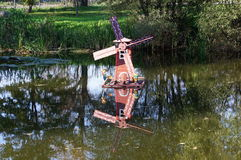 The layout of a windmill on a pond Stock Photography