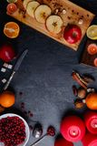 Layouts from slices of apples, a plate with cranberries, next orange and lemon, and burning candles. View from above. Layouts from a board with slices of apples Royalty Free Stock Photography