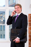Laywer or Businessperson in Office on the phone Stock Photo