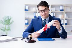 The laywer with diploma roll in legal profession eductional concept stock photo