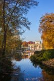 Lazienki Park With Palace On Water In Warsaw. Lazienki Park in Warsaw, Poland, lake and autumn foliage scenery with Palace on the Isle or Palace on the Water royalty free stock photos