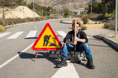 Laziness. Lazy guy on a  road works site, a concept Royalty Free Stock Photos