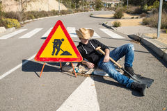 Laziness. Lazy guy on a  road works site, a concept Stock Photography