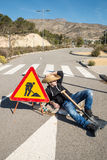 Laziness. Lazy guy on a road works site, a concept stock image