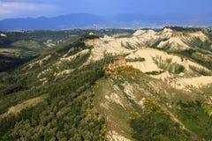 Lazio. Civita di Bagnoregio VT, Italy - May 15, 2016: Soft eroded clay landscape around Civita di Bagnoregio, Tuscia, Lazio, Italy stock photos