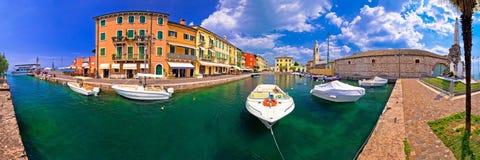 Lazise colorful harbor and boats panoramic view. Lago di Garda, Veneto region of Italy Stock Photo