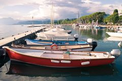 Small harbor on Lake Garda, Italy. Lazise, Italy - June 12, 2016: Small harbor with colorful boats on Lake Garda in Lazise, Italy Stock Images
