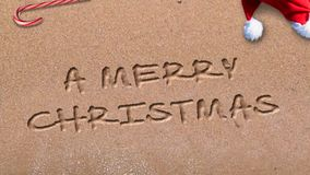 Lazo de la playa 4K de la Feliz Año Nuevo de la Feliz Navidad almacen de metraje de vídeo