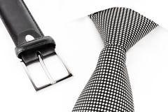 Lazo manchado blanco y negro y correa de cuero Foto de archivo libre de regalías