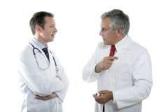 Lazo mayor de la maestría de las personas de los doctores que habla Imagenes de archivo