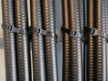 Lazos atados con correa del cable coaxial Imágenes de archivo libres de regalías