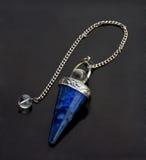 Lazurite pendulum Stock Images