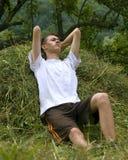 Lazy afternoon. Young man laying at hay Royalty Free Stock Image