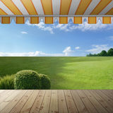 Lazy afternoon. Look from a wooden veranda stock photography