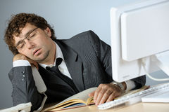 Lazy businessman. Horizontal image of young lazy businessman Stock Photos