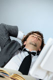 Lazy businessman. Vertical image of lazy young businessman Royalty Free Stock Photo