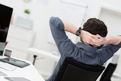 Lazy businessman relaxing at the office Stock Images