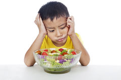 Lazy child to eat salad Royalty Free Stock Photos